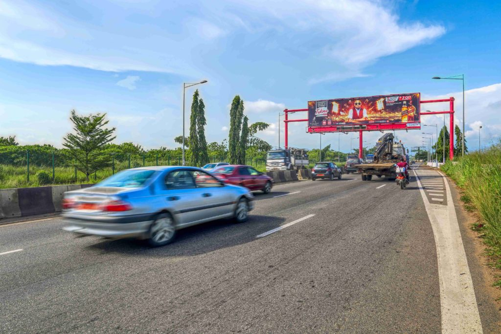 Billboard on busy highway in Douala, Cameroon